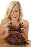 Woman with handfuls of cake smile — Stock Photo