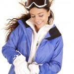 Woman ski jacked put gloves — Stock Photo