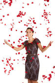 Woman showered with roses — Stock Photo