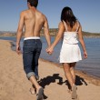 Hold hands walk beach — Stock Photo