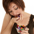 Putting jelly beans mouth — Stock Photo #11975600