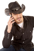 Cowboy on phone smile — Stock Photo