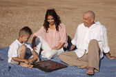 Family checkers sand — Stock Photo