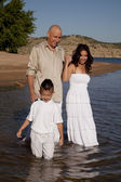 Family in whit in water — Stock Photo