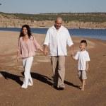 Family walking on beach happy — Stock Photo #11980097