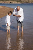 Father teach son to fish — Stock Photo