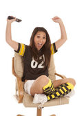 Football fan hands up remote — Stock Photo