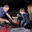 Stock Photo: Family working on car