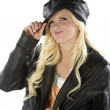 Girl holding black hat smirking — Foto de stock #12086229