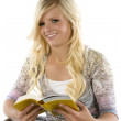 Girl reading yellow book. — Stock Photo