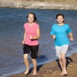 Stock Photo: Girls running on beach