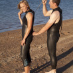 Helping wet suit — Stock Photo