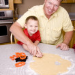 Father and son baking cookies — Stock Photo