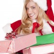 Mrs Santa handing present — Stock Photo