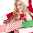 Stock Photo: Mrs Santa handing present