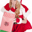 Mrs Santa open gift shhh — Stock Photo
