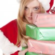 Mrs Santa looking around stack presents — Stock Photo