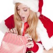 Mrs Santa open gift surprised — Stock Photo