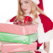 Mrs Santa smiling with presents — Stock Photo