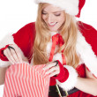 Mrs Santa wraps a gift — Stock Photo