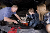 Family working on car — Stock Photo