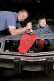 Father son working on car — Stock Photo