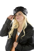 Girl holding black hat smirking — Stock Photo