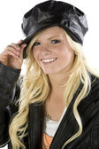 Girl holding tip of black hat — Stock Photo