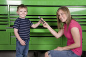 Giving a child a hammer — Stock Photo