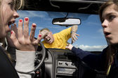 Hitting man in car — Stock Photo