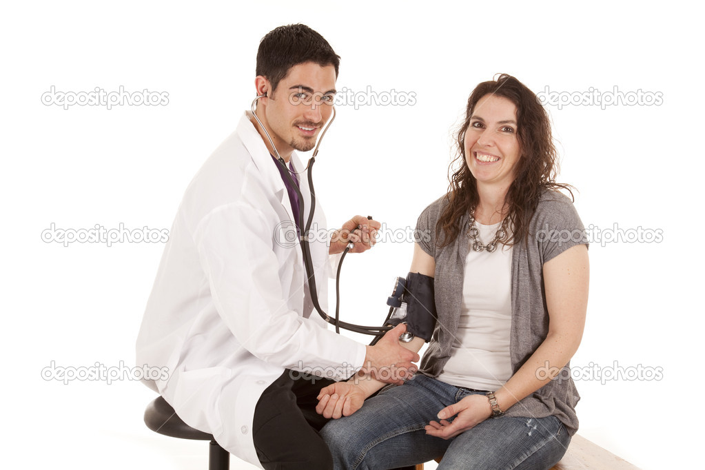 A doctor and patient smiling during a check up — Stock Photo #12085628