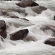 Water rolling over rocks - Stock Photo