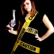 Woman caution gun — Stock Photo #12096133