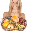 Woman holding out fruit basket — Stock Photo #12098045
