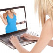 Woman looking at healthy woman in laptop — Stock Photo #12098613