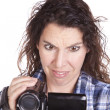 Woman watching video camera confused — Stock Photo