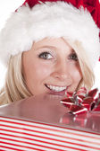 Santas helper peeking over present — Stock Photo
