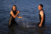 Splashing in water couple — Stock Photo