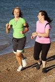 Two women jogging — Stok fotoğraf