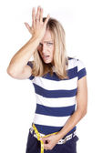 Woman blue and white frustrated with measurement — Stock Photo