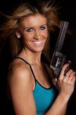 Woman gun big smile — Stock Photo