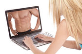 Woman looking at a man in laptop — Stock Photo
