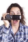 Frau beobachten videokamera angst — Stockfoto