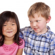 Young boy looking at young girl - Stock Photo