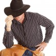 Cowboy touching hat leaning — Stock Photo #12102518