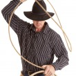 Cowboy with rope over head - Stock Photo