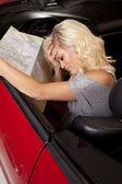 Car woman map sad — Stock Photo