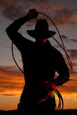 Cowboy in sunset with rope — Stock Photo