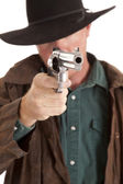 Cowboy looking down pistol — Stock Photo
