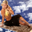 Genie on a flying carpet looking back - Lizenzfreies Foto